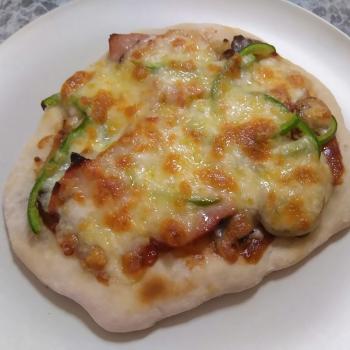 Adam Pizza dough first slice